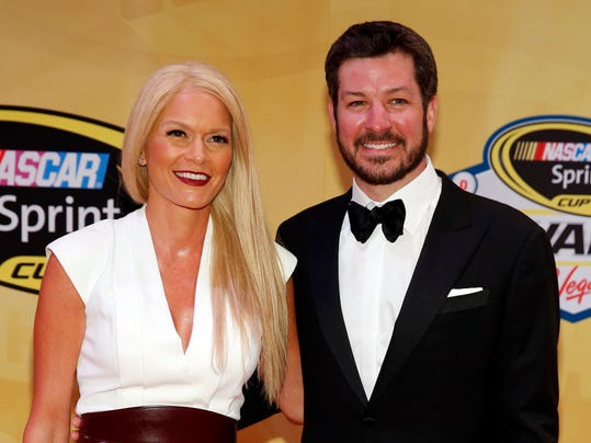 "FILE - In this Dec. 4, 2015, file photo, Martin Truex Jr. and his girlfriend, Sherry Pollex, pose on the red carpet before the NASCAR Sprint Cup Series auto racing awards in Las Vegas. Once a stock car poster boy for bad luck, Truex could be considered among a handful of favorites to win ""The Great American Race."" Coming off the best season of his career, Truex found his home at Furniture Row Racing and was one of four drivers racing for the Sprint Cup title in the season finale. But for all his racing triumphs last season, Truex's true championship headline came this week when longtime girlfriend Sherry Pollex announced she was cancer free following her last chemotherapy treatment for ovarian cancer. (AP Photo/John Locher, File)"