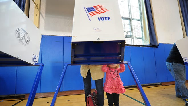 A voter and her daughter are pictured in Glens Falls, N.Y. Nov. 4, 2014.