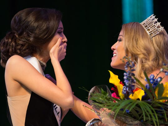 Miss New Mexico USA 2018 Kristen Leyva, left, reacts as Miss New Mexico USA 2017 Ashley Mora, congratulates her at the conclusion of the pageant held at Oñate High School on Sunday, January 28, 2018.