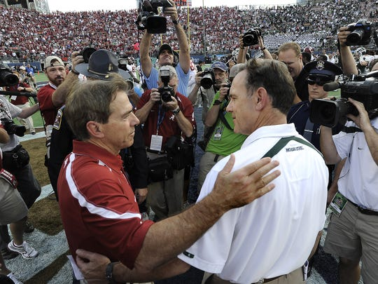 Alabama coach Nick Saban, left, and MSU coach Mark Dantonio meet after MSU's 49-7 loss to Alabama on Jan. 1, 2011 in the Capital One Bowl. This in the first meeting since between Saban and Dantonio. Dantonio was on MSU's staff at Michigan State from 1995-99.