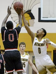 Greece Athena's Christian Jones, right, blocks a shot by Hilton's Tah'Jae Hill during a regular season game at Greece Athena High School on Monday, Jan. 22, 2018. Greece Athena beat Hilton 70-48.