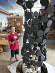 Connor Velier, 9, of Sheboygan, studies a carbon tube at a new nano exhibit at the Above and Beyond Children's Museum Wednesday, July 1, in Sheboygan.