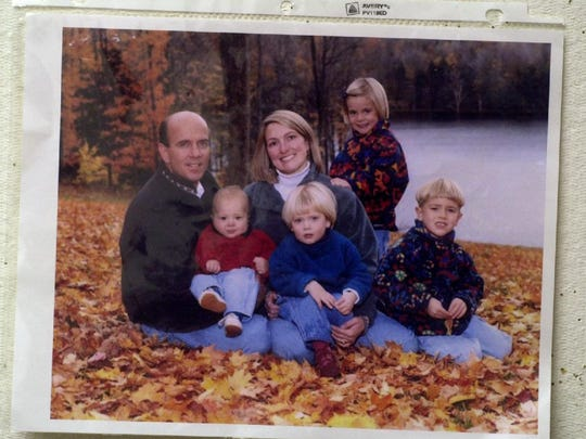 A Harris family photo on the bulletin board in the office at the New York State Police's Owego barracks that investigators are using track down the 800 leads in the case, shown in 2002.