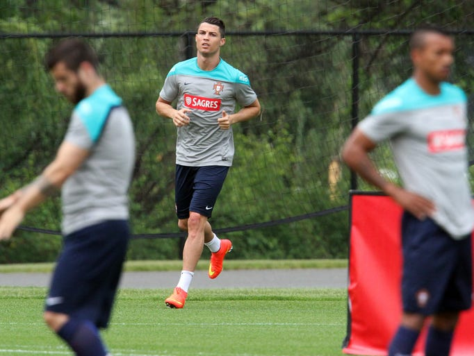 The Portuguese National Soccer team practiced at the New York Jet's training facility in Florham Park in preparation for an international friendly match against Ireland.   Here soccer superstar Cristiano Ronaldo (center) jogs around the practice field  On Tuesday June 3,2014 Photo: Mark R. Sullivan/Staff Photographer