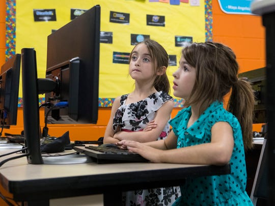 Amaya Woodall (left) and Kaylee McKenney research how