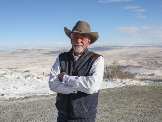Bill Miller, who oversees the development of the Chokecherry and Sierra Madre wind farm for the Anschutz Corporation, looks out at the snow-covered Overland Trail Ranch, the intended site of the wind farm, on Dec. 5, 2016.