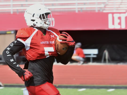 Running back Kentel Williams breaks away for a rush during a drill at Austin Peay's fall camp practice on Aug. 10.