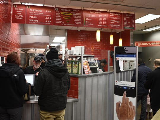 Customers line up to order halal food at Juicy Platters.