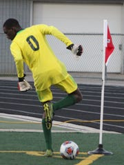 Senior goalie Christion Williams comes out of the net and dances to stay inbounds in the corner of the field to keep the ball in play.