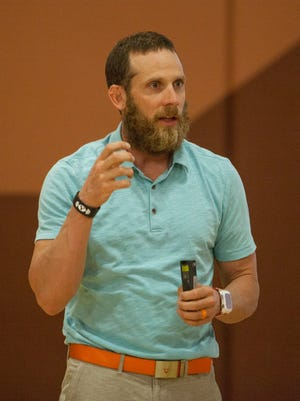 James Lawrence, known as the Iron Cowboy, visits Sunrise Ridge Intermediate School to discuss what it took to complete 50 Ironman races in 50 days Thursday, Aug. 27, 2015.