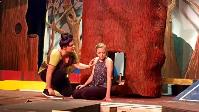 """The Witch (Whitney Snow) implores Rapunzel (Ali Newport) to stay with her during a scene from """"Into the Woods"""""""