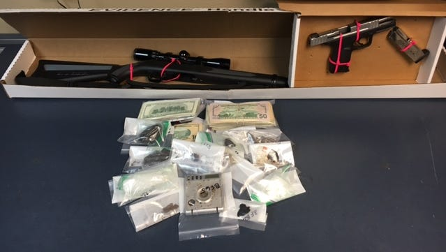 Detectives seized cash, guns, paraphernalia and drugs during a bust at a Jefferson home Wednesday.