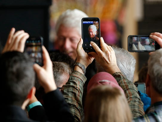 Supporters reach to capture photos of former US President