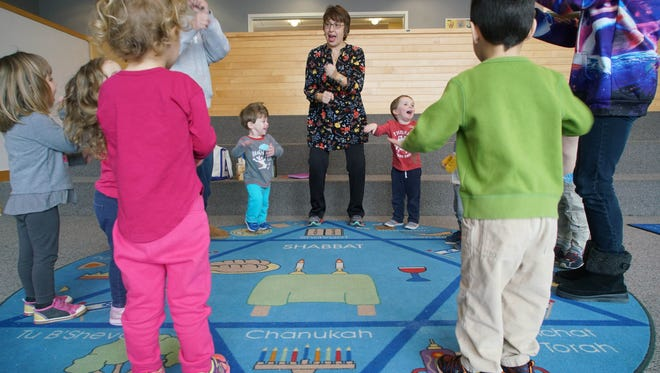 Marla Friedman leads a group of pre-schoolers in a song at the Early Childhood Center located in the Seigel Jewish Community Center. A Missouri man has been charged with making bomb threats to JCCs across the nation.