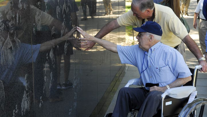 In this 2007 file photo, veteran George Treush and guardian Dick Hall reach out to touch the wall at the Korean War memorial during the Honor Air trip to Washington D.C. for 101 WWII veterans from Asheville and Buncombe County.