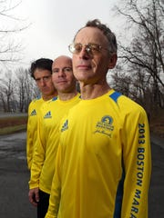 Patrick Parietti of Nyack, left, Doug McEnroe, of Stony Point, and Michael Nusblat of Stony Point, all ran last year's Boston Marathon. The three, photographed at Rockland Lake State Park April 15, 2015, are all returning to run in this year's marathon.