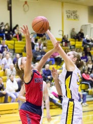 New Oxford's Kaelyn Long takes a shot while being guarded