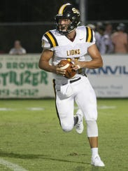 Scotts Hill's Cody Carter (14) runs with the ball against