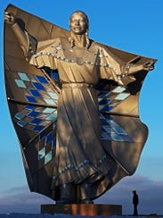 """The """"Dignity"""" statue stands near Chamberlain."""