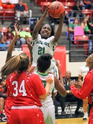 Ft. Myers guard Autumn Giles goes up for a basket as