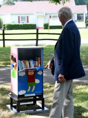 Jackson City Mayor Jerry Gist looks inside the Little