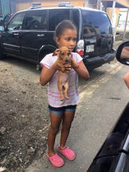 A young girl with a dog in Puerto Rico. The girl's