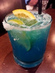 Add a splash of blue curacao to a margarita for a nice