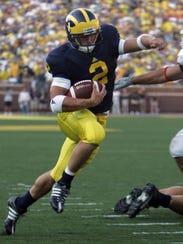 Michigan running back Sam McGuffie runs past Utah's