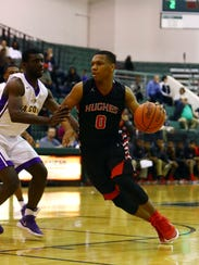 Hughes forward Shawn Hawkins looks to drive the lane