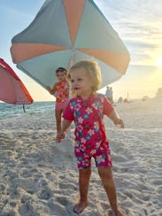 Ms. Cheap's granddaughters Brinkley and Maddie Miller enjoy a day at the beach.