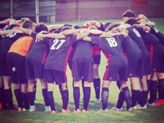 """Members of the Stevens Point Area Senior High boys soccer team participated in a program called """"Coaching Boys into Men"""" program to improved behavior toward girls and women."""