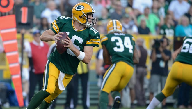 Green Bay Packers quarterback Scott Tolzien (16) rolls out in the first quarter of a preseason game between the Green Bay Packers and the New Orleans Saints in September 2015.