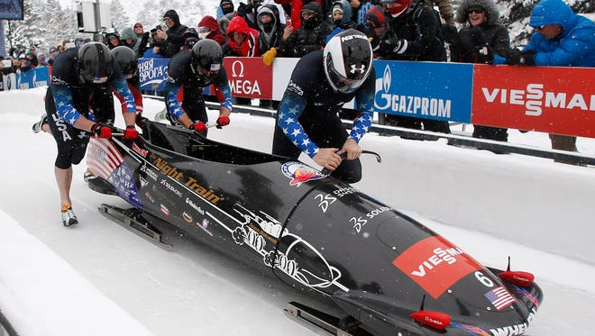 The U.S. four-man bobsled team piloted by Steven Holcomb competes during the World Cup at Utah Olympic Park on Saturday.