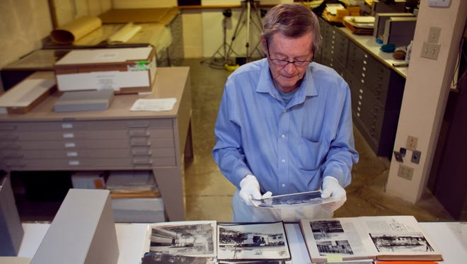 Pictured in 2010, Bruce Brooks Pfeiffer looks through photographs acquired by The Frank Lloyd Wright Foundation. Pfeiffer, once an apprentice to Wright, died Dec. 31, 2017.