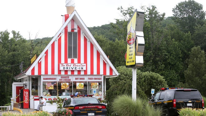 State police cars and yellow crime scene tape at The Red Rooster Drive-In on Route 22 in Southeast Sunday, July 31, 2016, following a burglary