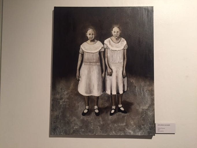 A portrait of the Siamese twins hangs on display.