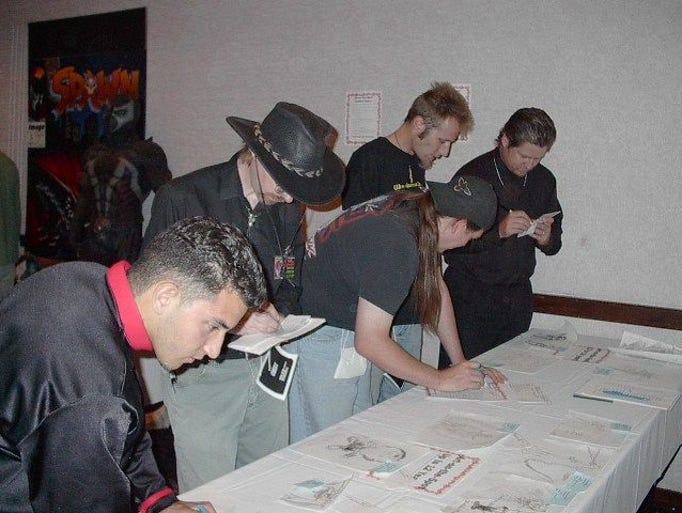 Judges look at entries to an art contest at Phoenix