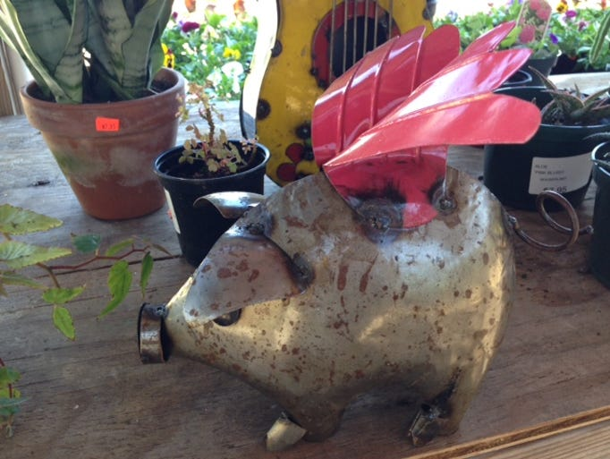 Hand-crafted metal flying pig with pink wings, Bailey's