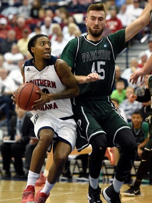 Southern Indiana's Cortez Macklin is fouled while driving to the basket by Goran Zagorac of Wisconsin-Parkside during the first half of the game at the PAC in Evansville Thursday.