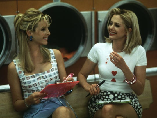 "Lisa Kudrow (left) and Mira Sorvino play longtime friends in ""Romy and Michele's High School Reunion"" (1997)."