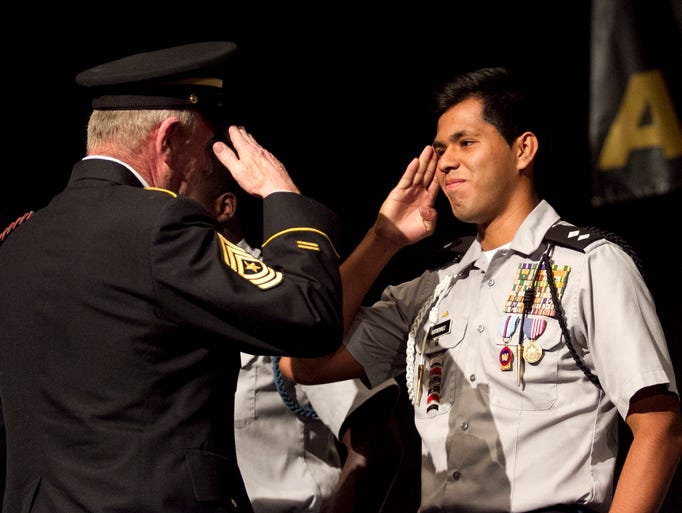 Miguel Gutierrez is awarded a gold medal for an American Legion Award for Demonstrating Military & Scholastic Excellence during the School District of Lee County JROTC Awards Ceremony Thursday evening at Harborside Event Center in Fort Myers.
