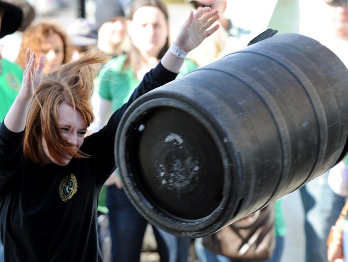 Ashley Griffin, of Carmel, has her hair fly while participating in the keg toss during Brockway Pub's St. Patrick's Day celebration, Saturday, March 15, 2014, in Carmel.
