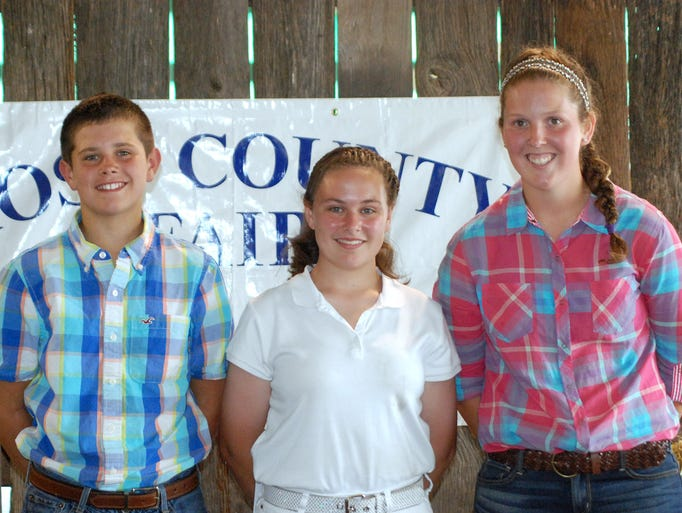 The Junior Fair Showman of Showman Contest winners are, from left, Junior Showman of Showman winner Ben Corcoran, of We Feed 'Em Well 4-H Club, Intermediate Showman of Showman winner Alexandrea Stewart, of We Feed 'Em Well 4-H Club, and Senior Showman of Showman winner Alexis Putnam, of A-1 Warriors 4-H Club.