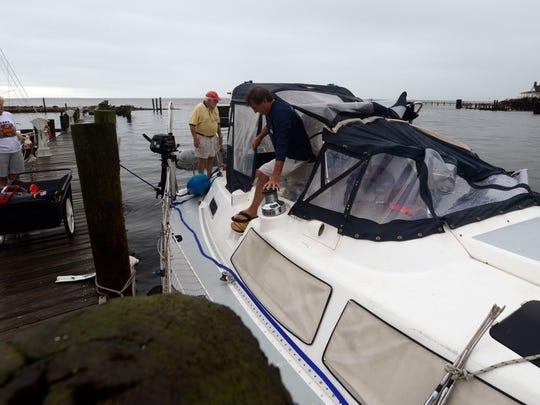 Crew members of the Midnight Sun II remove supplies