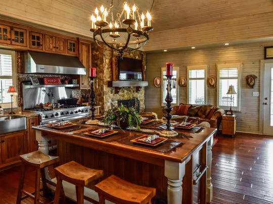 The kitchen in the home features wood floors and a fireplace.