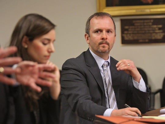 Trevor Cooney, right, an attorney for the New Jersey Schools Insurance Group, listens to comments. A hearing is held in Middlesex County Superior Court involving the Edison Board of Education and the NJ Schools Insurance Group to argue if the insurance should fully fund the replacement of the new James Monroe School following a fire last March, February 03 2015 in New Brunswick NJ. Kathy Johnson/staff photographer EST 0204 James Monroe School