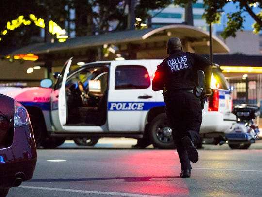 Dallas Police respond after shots were fired at a Black Lives Matter rally in downtown Dallas on July 7, 2016. Dallas protestors rallied in the aftermath of the killing of Alton Sterling by police officers in Baton Rouge, La. and Philando Castile, who was killed by police less than 48 hours later in Minnesota.