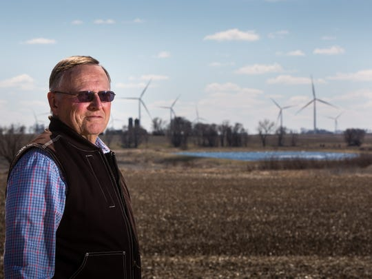 Daryl Haack stands on his farm in Primghar Thursday, April 6, 2017. Haack says the turbines mean jobs for small towns like his.
