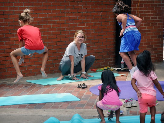 During the Kids Yoga class at the Farmers Market, Tuesday,