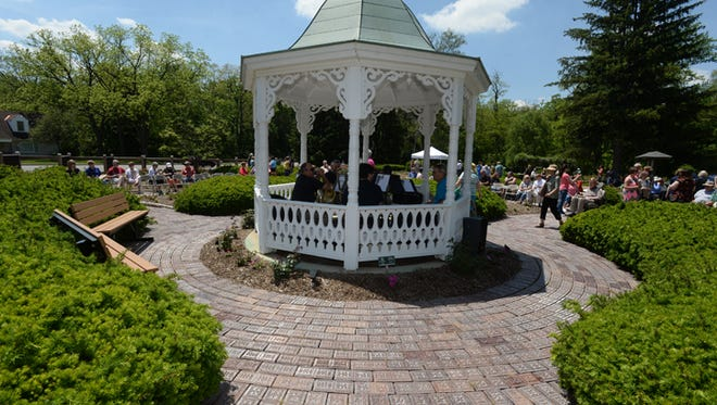 The Richmond Symphony Brass performs Saturday, May 23, 2015, during the Chocolate Garden at the Richmond Rose Garden.